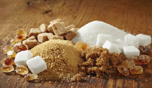 various types of sugar on wooden table - Bremer Authentic Ingredients